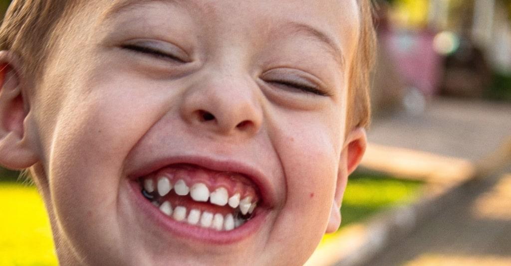 close up photo of boy smiling